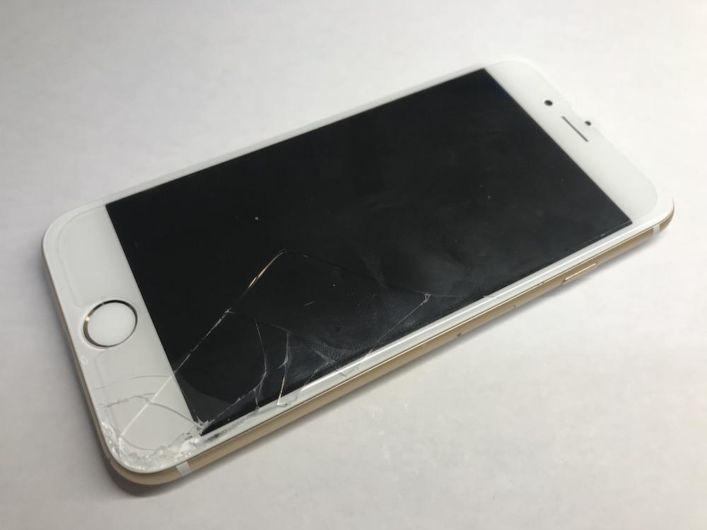 実際のホームボタン付近の画面が割れたiPhone6sの端末
